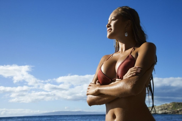 Woman enjoys the beach in Fort Lauderdale after breast augmentation.